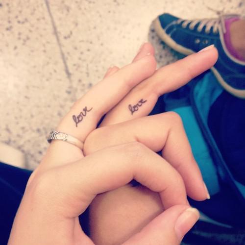 Love Friendship tattoo On Fingers