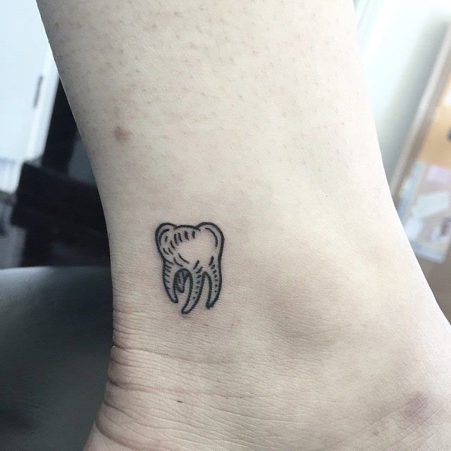 Small Molar Tattoo On Ankle