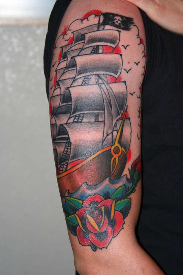 Beautiful pirate ship traditional tattoo on right half sleeve for Beautiful half sleeve tattoos