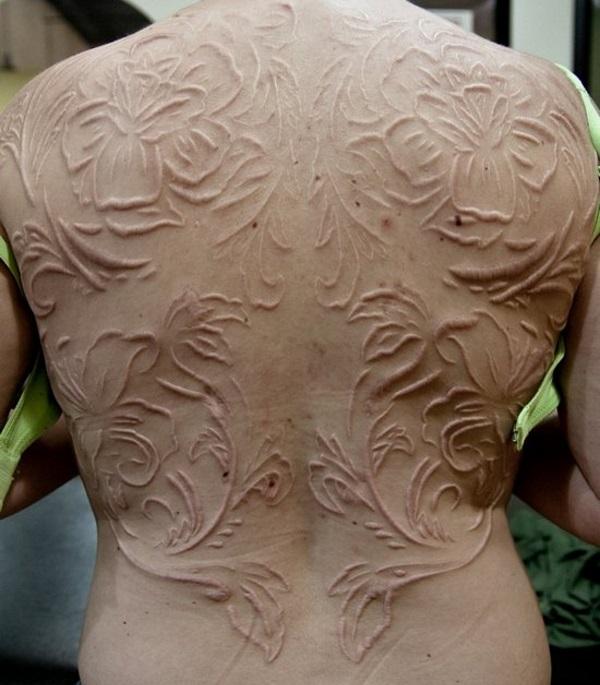 7df68e472a38c Big Full Back Flowers Scarification Tattoo