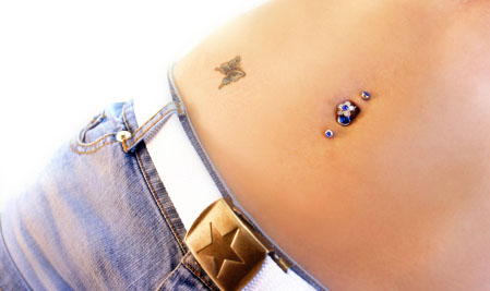Butterfly Tattoo And Industrial Navel Piercing