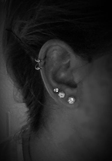 Dual Cartilage And Triple Earlobe Piercings On Right Ear