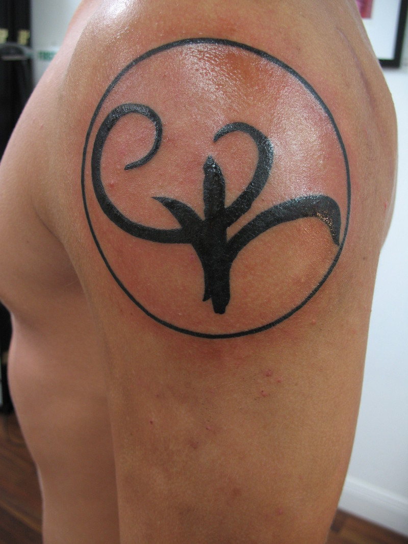 25 strength symbol tattoos ideas and designs greek symbol for strength tattoo on left shoulder biocorpaavc Choice Image