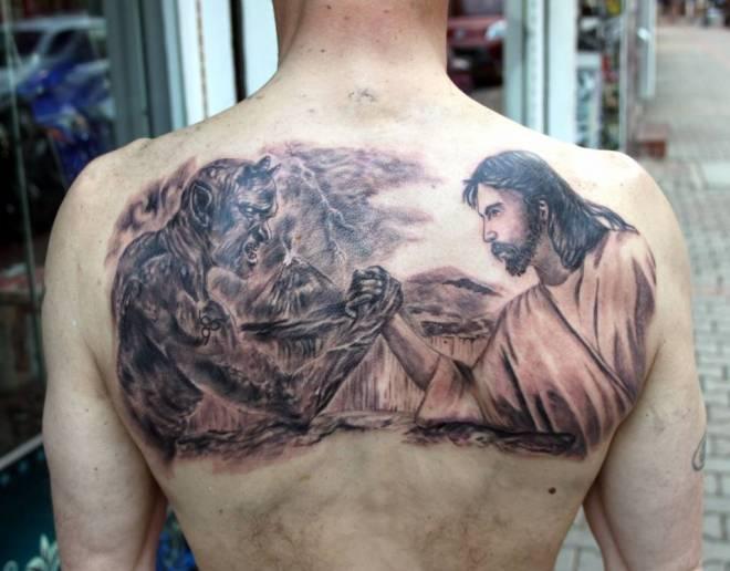 jesus vs satan tattoo on upper back. Black Bedroom Furniture Sets. Home Design Ideas