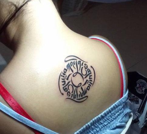 kindness tibetan symbol tattoo on upper back. Black Bedroom Furniture Sets. Home Design Ideas
