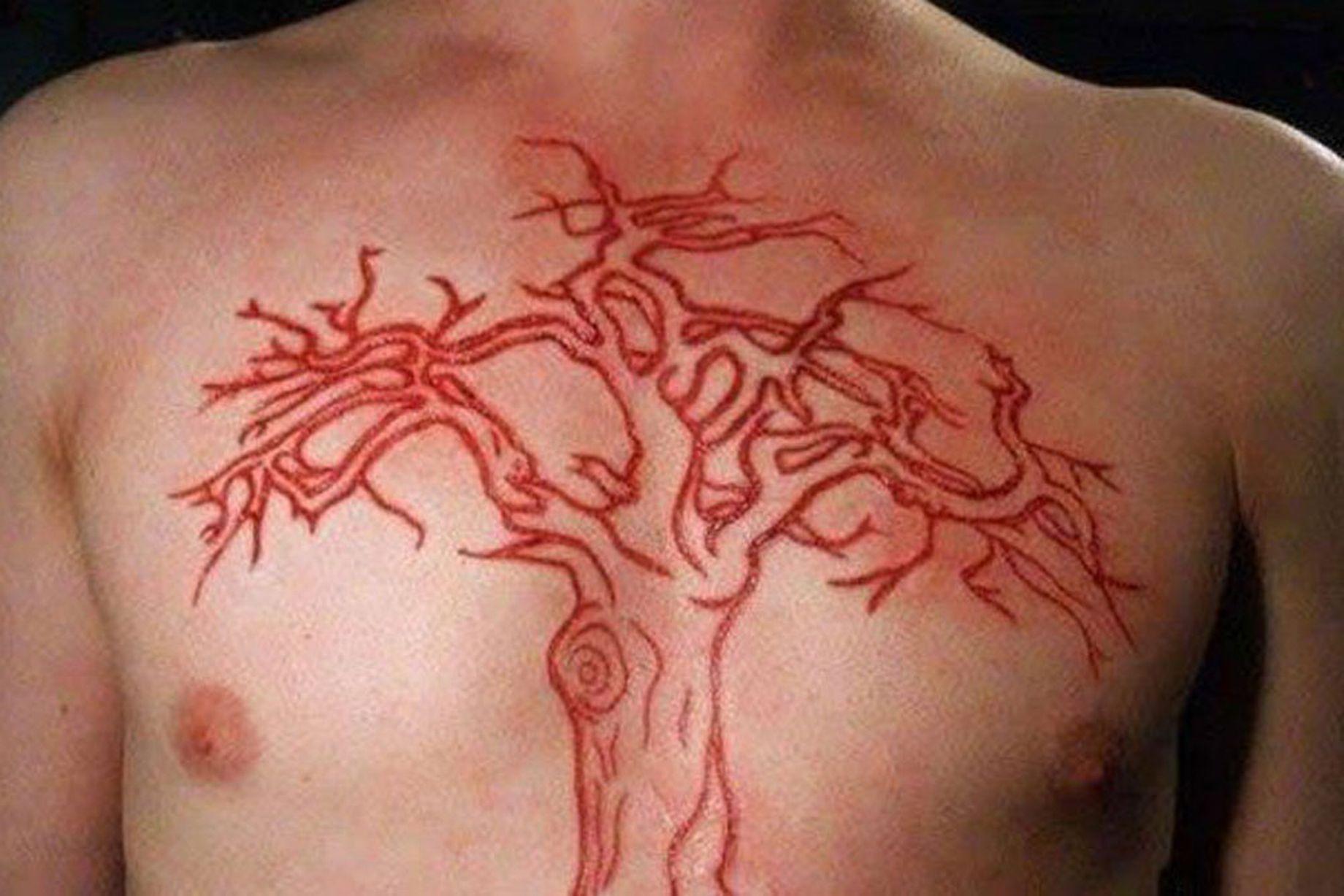 9c7de952c Leafless Tree Scarification Tattoo On Chest For Men