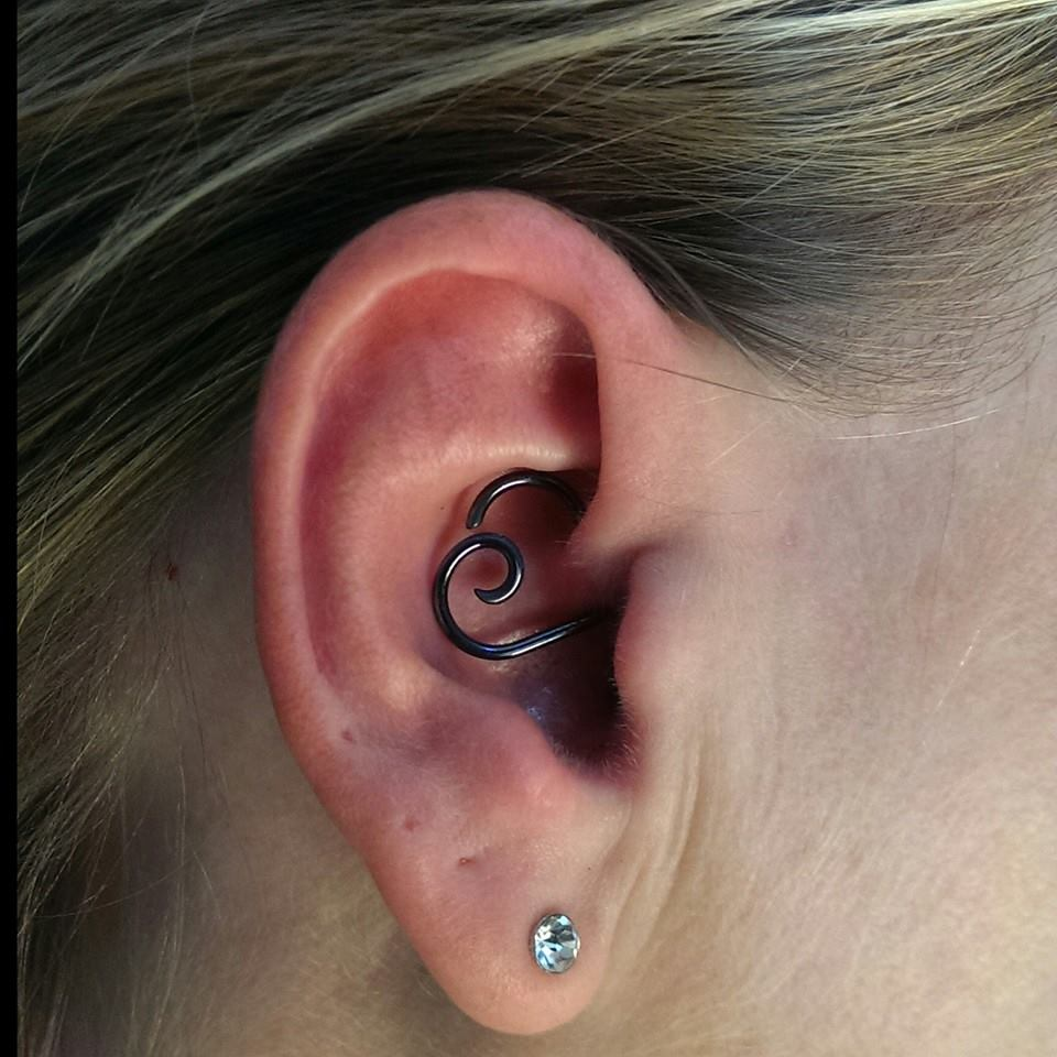 lobe and daith piercing on right ear