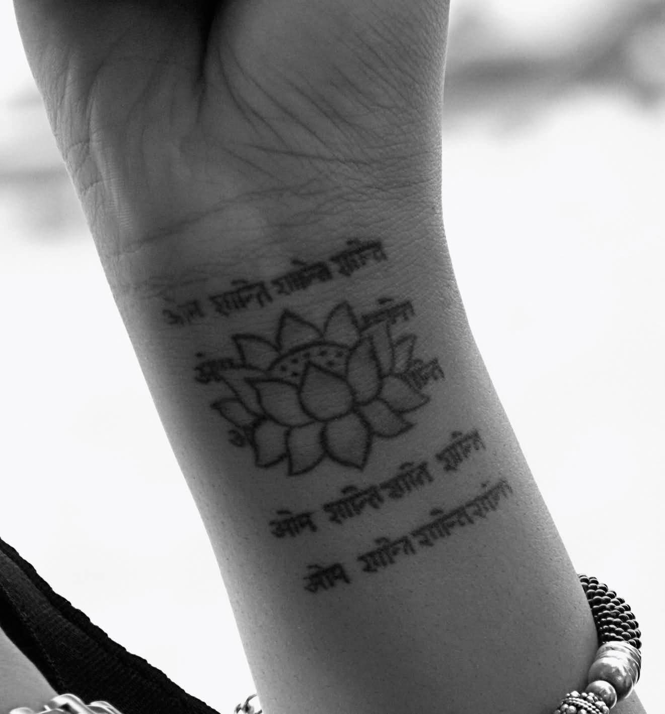 68 best spiritual tattoos ideas lotus and sanskrit spiritual tattoo on wrist thecheapjerseys Choice Image