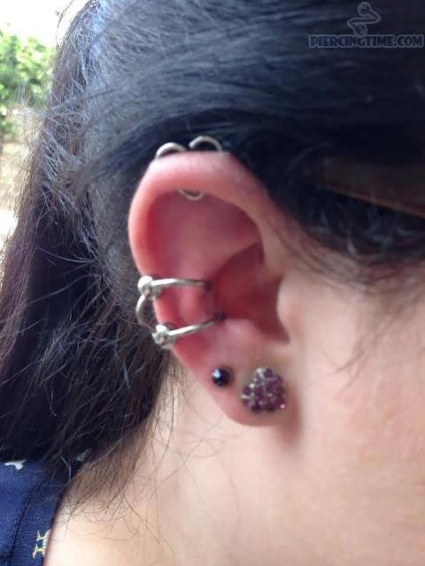 Nice Dual Lobe And Double Conch Piercing On Girl Right Ear