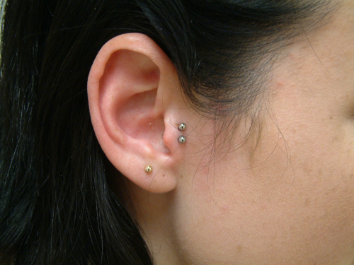 Nice Right Ear Lobe And Double Tragus Piercing