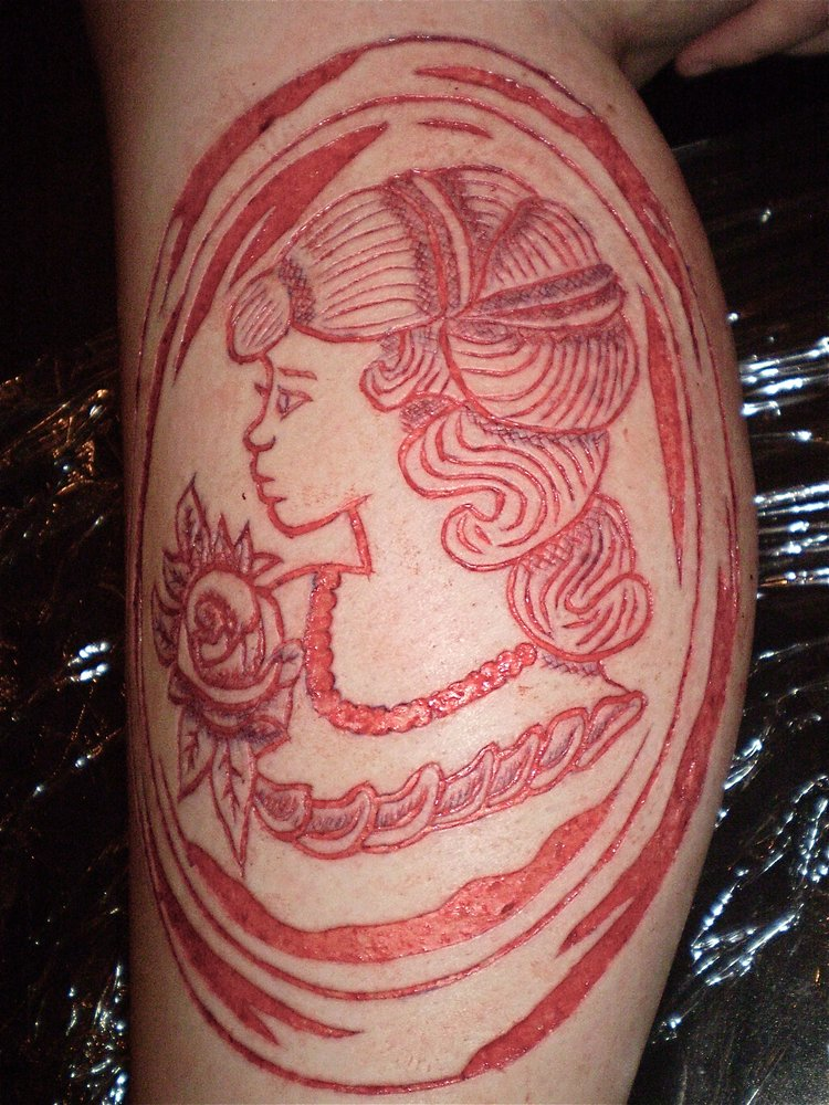 25 scarification tattoos for women. Black Bedroom Furniture Sets. Home Design Ideas