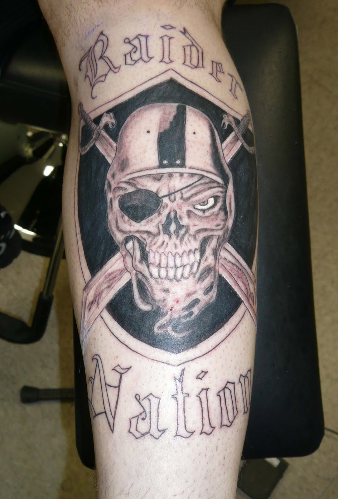 Oakland raider logo with raider nation tattoo for Oakland raiders tattoos designs
