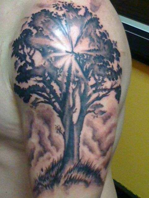 Outstanding Tree Of life Tattoo On Left Half Sleeve For Men