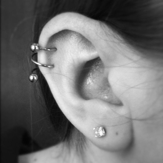 right ear lobe and spiral piercing