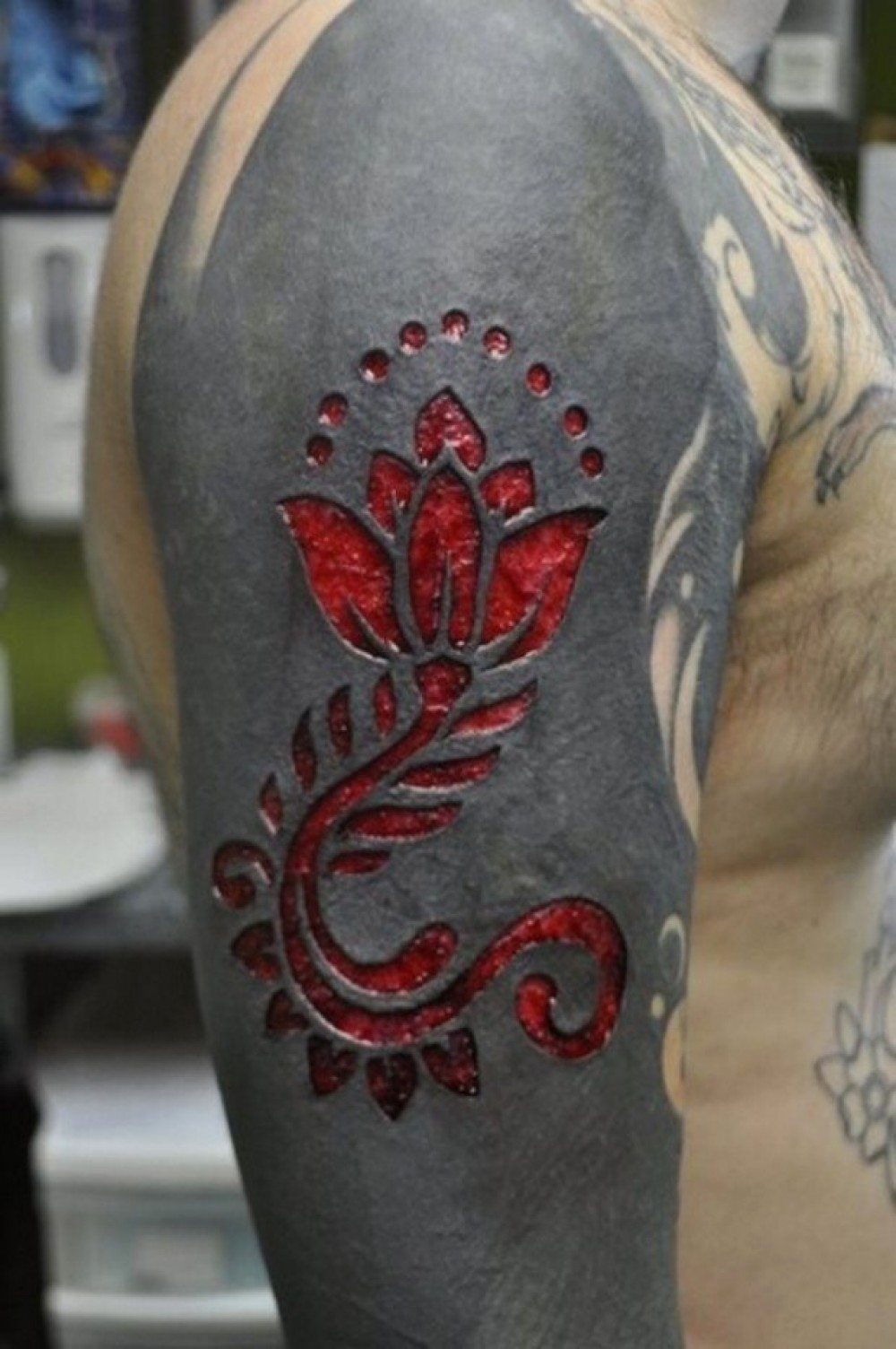 Scarification tattoos on sleeve