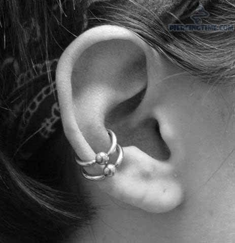 bead ring outer conch piercing on right ear. Black Bedroom Furniture Sets. Home Design Ideas