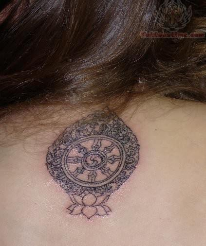 Small Round Tibetan Symbol Tattoo On Upper Back
