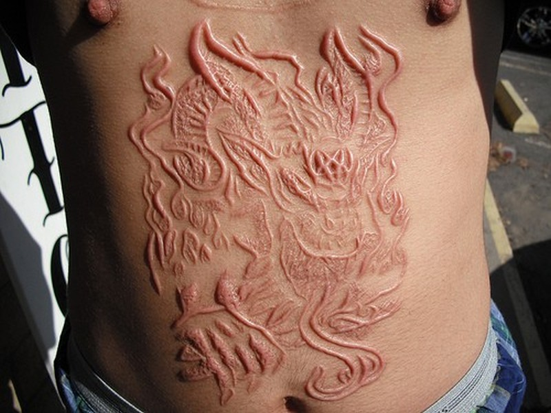 Unique scarification tattoos designs