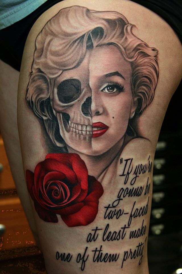 Awesome Two Faced Marilyn Monroe With Rose Tattoo On Left Thigh