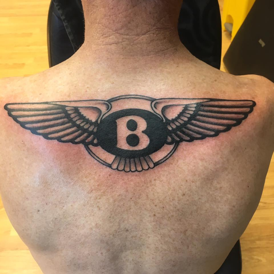 510825f5d Bentley Logo Tattoo On Upper Back by Skinshokz Tattoo