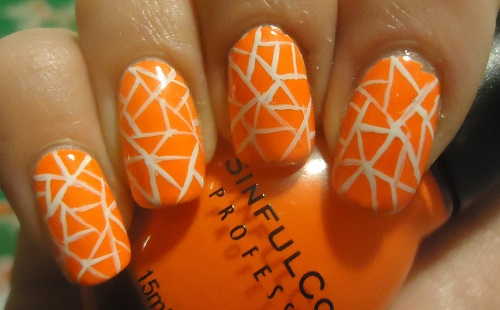 Acrylic Orange And White Design Nail Art