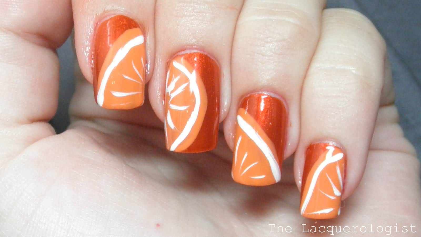 Adorable Orange And White Nail Art