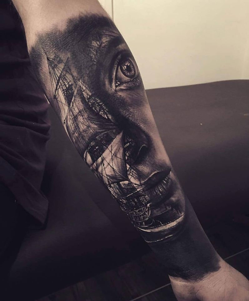 Amazing black ship and face tattoo on arm