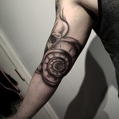 6b2168c987f31 Awesome Spiral Clock Tattoo On Upper Inner Arm