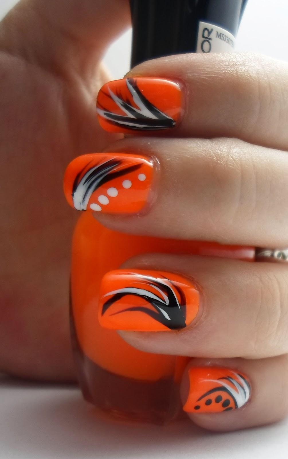 Beautiful Orange Nail Art With Black And White Swirls Design