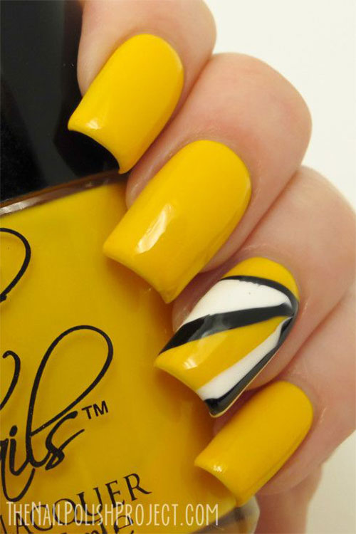 Beautiful Yellow Nails With Black And White Rays Design Idea