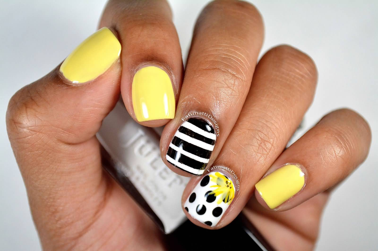 Black And White Polka Dots Nail Art With Yellow Accent Flower With