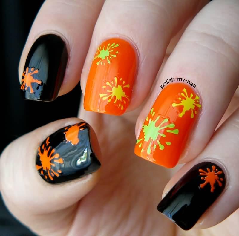 Black Glossy Nails With Orange Color Splatter