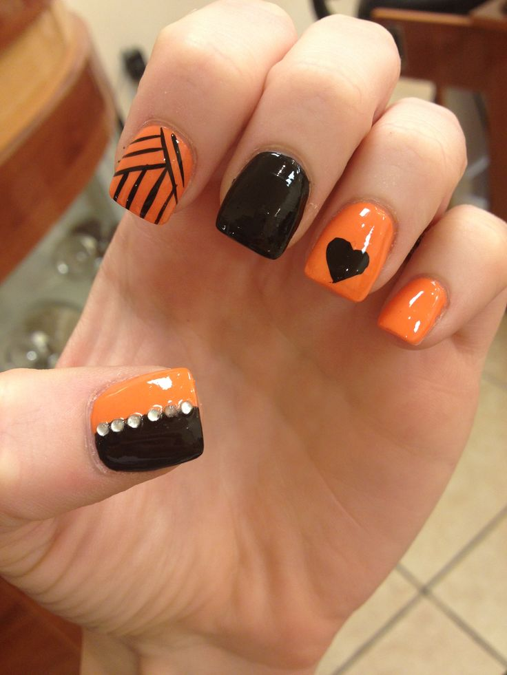 Black Heart On Orange Nails - 60 Stylish Orange And Black Nail Art Design Ideas