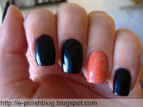 Black Nails With Accent Orange Glitter Nail Art