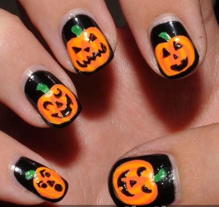 Black Nails With Orange Pumpkins Nail Art