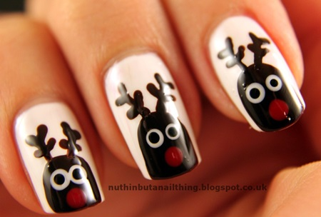 Black Reindeer On White Nails Christmas Nail Art