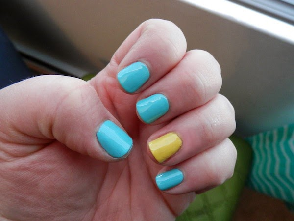 Blue Nails With Accent Yellow Nail Art