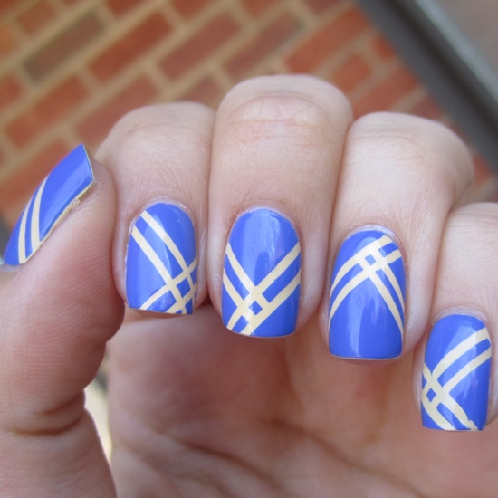 - Blue Nails With Beige Striping Tape Nail Art