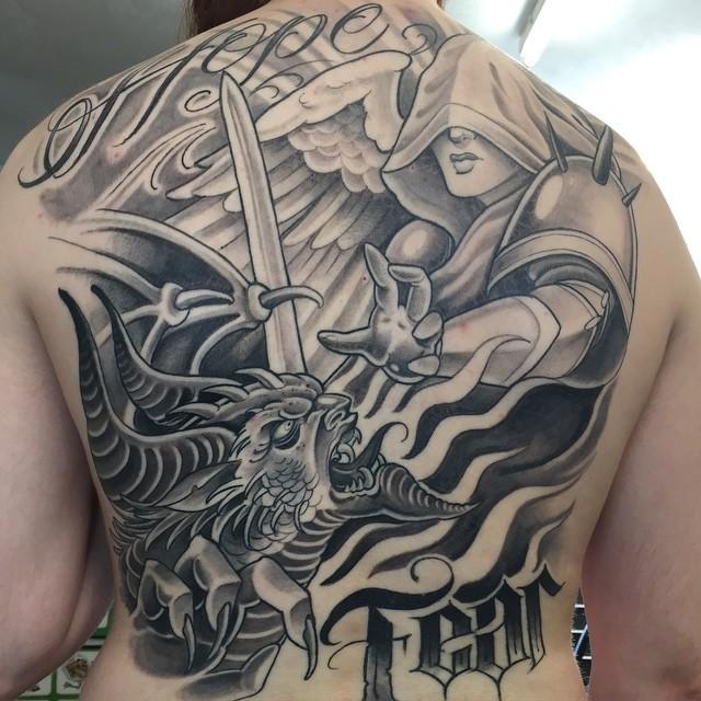Name tattoo designs on bicep bicep name tattoo ideas - Injured God Angel Western Tattoo On Back For Men