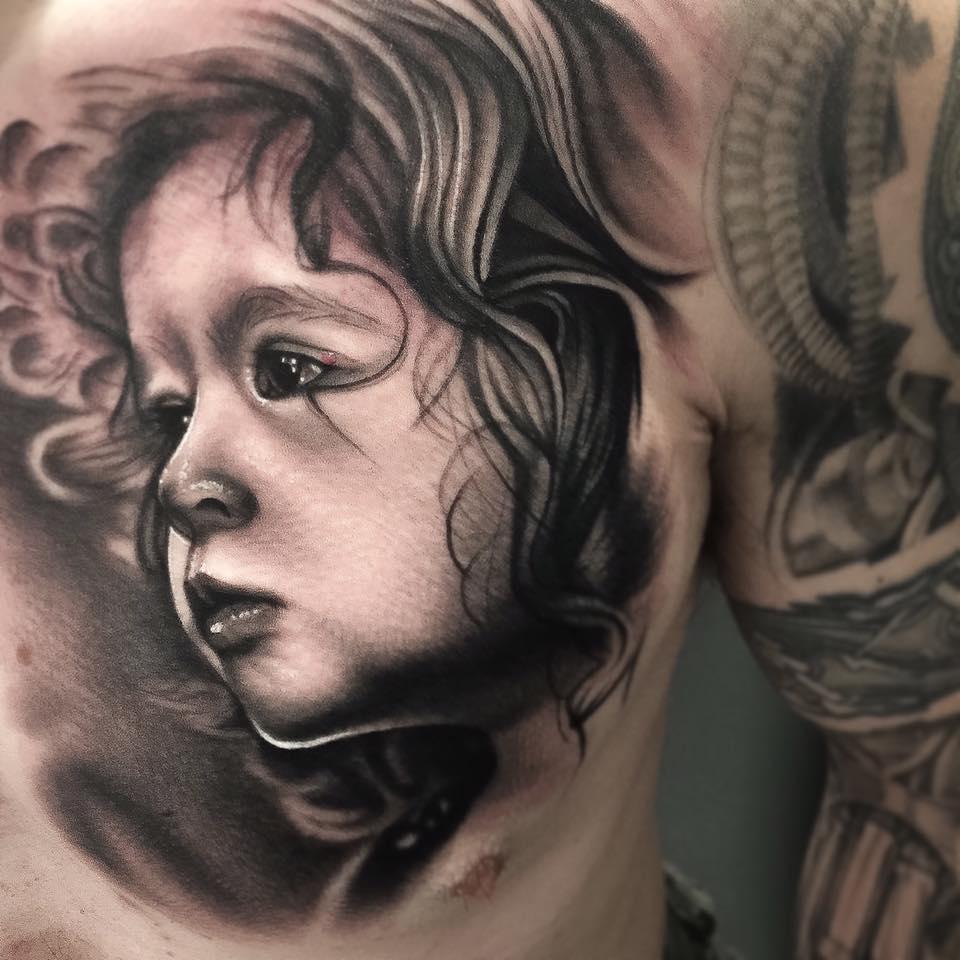 Child Portrait Tattoo On Chest