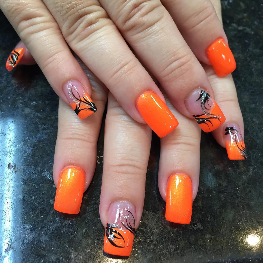 Dazzling Orange With Black Floral Design Nail Art