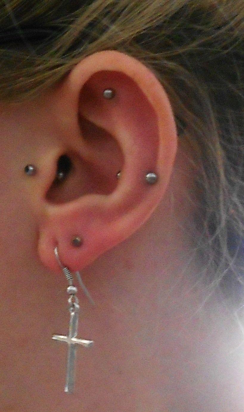 Rook And Snug Piercing With Green Barbell Ear Piercings Snug