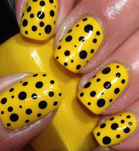 Glossy Yellow Nails With Black Polka Dots Nail Art
