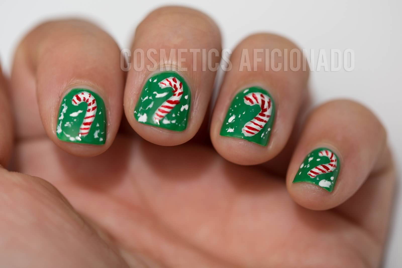50 most stylish christmas nail art ideas green short nails with candy cane christmas nail art prinsesfo Choice Image