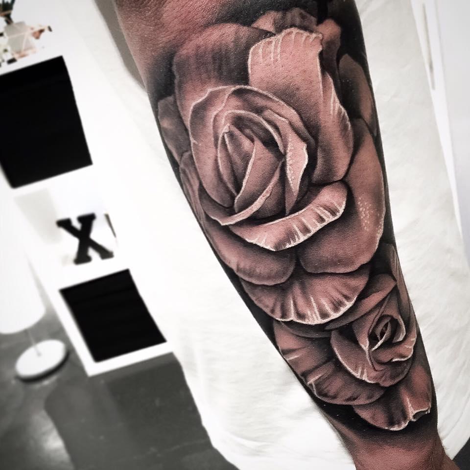 da72833f1 Grey ink 3D rose tattoo on arm