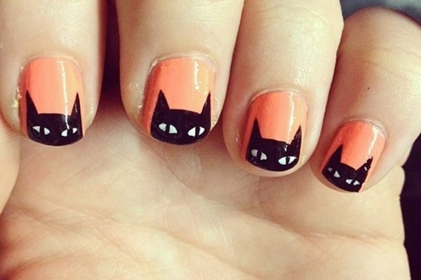 Light Orange Nails And Black Cat Face Design Nail Art