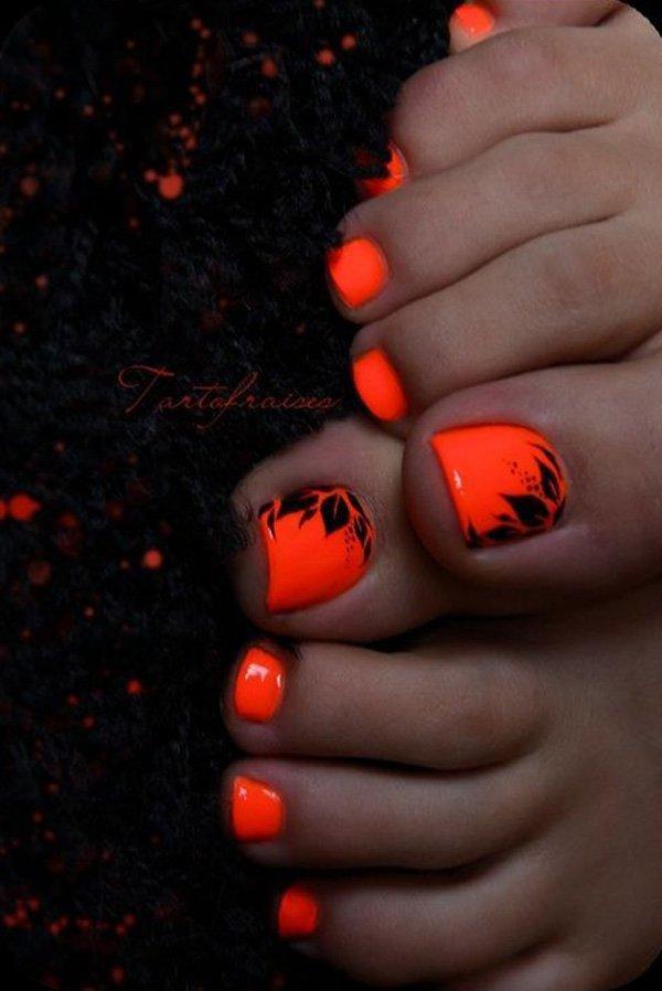 Neon Orange Toe Nails With Black Leafs Design Nail Art