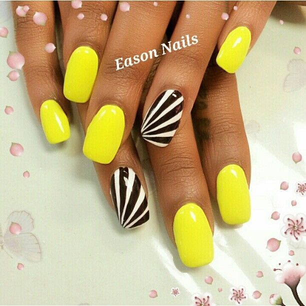 Neon Yellow Nails With Black And White Rays Design Idea
