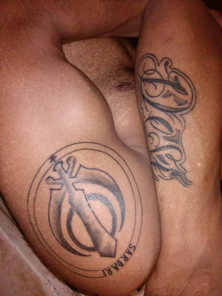 Nice Khanda Circular Symbol Tattoo On Shoulder By Atwal Saab