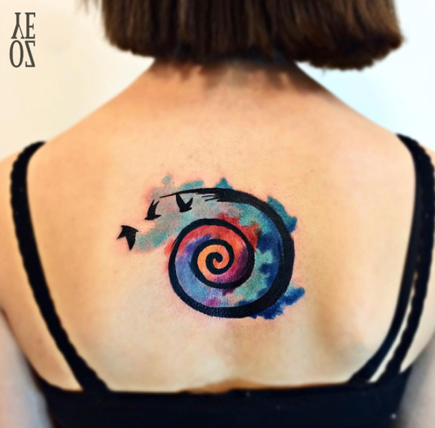 f31d85e15 Nice Watercolor Spiral Tattoo On Upper Back By Yeliz Ozcan